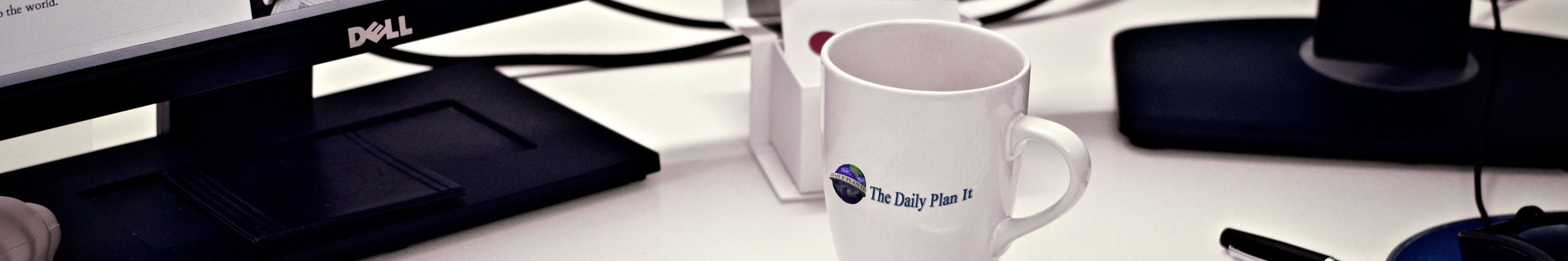 Daily Plan It - Where Your Business is The Center of Our Universe. Desk with coffee mug